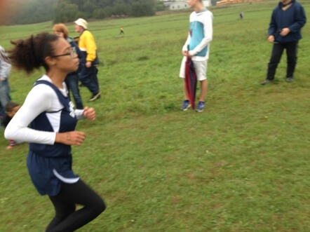 Cross-country runner participating at a tournament.